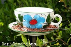 Homemade bird feeder. I thought this was a simple, great idea. Easy to make. Water in the cup and birdfood on the plate.  The spoon is just decor. Great gift idea too!