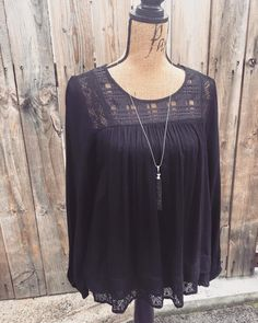 New! Black blouse from Mystree! We love the flow of this top and the lace detailing around the collar and hem.