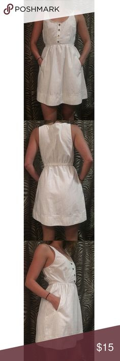 Casual Striped Linen Dress This is the perfect dress for a casual night out. Off-white with anal black stripes. Front details four copper & black buttons. Dress also has two pockets (praise). 85% Polyester, 15% Linen. Hand Wash. COPE Dresses
