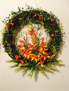 Handmade 18in grapevine wreath, great for any occasion inside or out. Put in your kitchen, living room bathroom, front door. A lovely addition to any home décor. This piece as a beautiful cascade of orange and green cone like accents flowing top of wreath to give focus to the