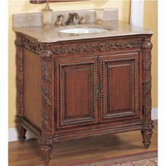 This 24 inch Tuscany Vanity by Empire brings a unique look to your bathroom with its ornate carved decorations. Store bathroom essentials inside the two cabinet doors of this bathroom vanity base.