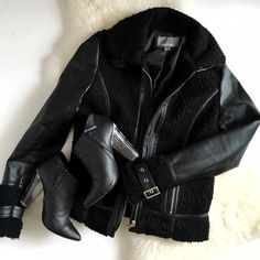 Boucle Leather Sleeve Moto Jacket This black leather trim coat is essential for chilly weather. It features zip pockets, two buckle strap details at collar and wrists, boucle texture throughout, vegan leather sleeves and piping, and silver hardware. Only worn 2 times, in excellent condition. No trades. Not in a rush to sell this one so only letting go of it for the right price. Lucite booties also available in separate listing. Tinley Road Jackets & Coats