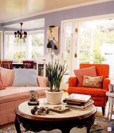 Red in this family room is easy to live with. Using different intensities of red and softening it with that yummy blue-gray wall is a lovely color scheme. (photo Art of Accessorizing, Christi Carter)