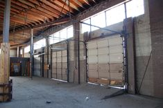 Maybe this is what those garage doors look like from the interior...   Hughes Warehouse Adaptive Reuse,Before. Image © Scott Adams, AIA