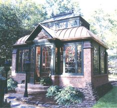 A little conservatory will make all the difference - make it look a little built in. get some brick in with the pre-fab glass and metal