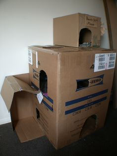 diy cardboard cat houses | Tutorial: DIY Cat Tree / Condo / Resort from Cardboard Cardboard Cat ... I've got boxes everywhere so why not?!?