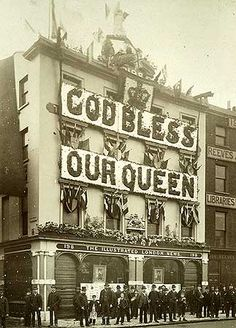 Exterior view of the offices of the Illustrated London News, decorated for Queen Victoria's Golden Jubilee celebration. 1887