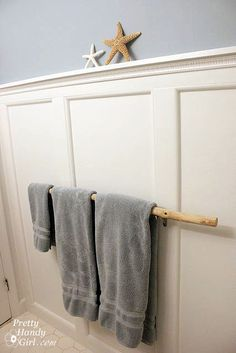 Branch Hand Towel hanger (just saw some awesome bamboo sticks at Dollar store) PERFECT cheap idea :D