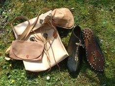 Various bags and a pair of shoes I built after Roman finds spanning the 1st to the 3rd cent AD