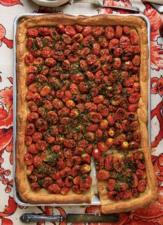Made with ripe cherry tomatoes, fragrant herbs, and a buttery crust, this gorgeous, rustic tart is a showstopper.