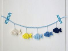 Tine from A French Touch demonstrates how easily you can create a mobile or garland for the nursery. Combine beautiful colours together to make this beautiful garland mobile.