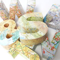 Letters covered by a map. I would do this! I'm terrible at geography, but I think maps and globes are beautiful!