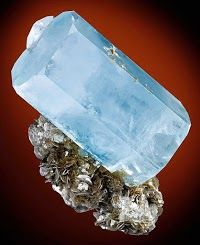 Large doubly terminated Aquamarine crystal atop Muscovite!