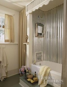 old shutter over tub to conceal shower curtain rod