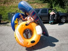 World photo/Don Seabrook:   Floaters are flocking to local rivers to cool off in the hot weather this week.