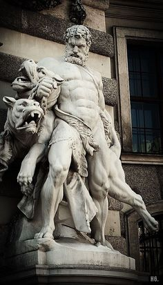 Hercules and Cerberus. Hofburg palace. Vienna. Austria ---- cerberus doesn't quite look like a dog or a lion...