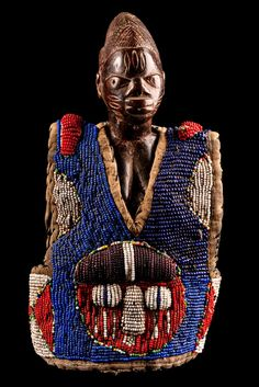Africa | Ere ibeji figure with beaded vest from the Yoruba people of Nigeria | Wood, textile, glass beads