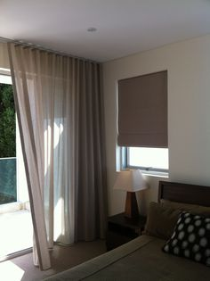 S fold sheer curtain in linen blend fabric with coordinated Soft Fabric Roman blind with blockout lining. Great combination of different but complimentary window coverings utilizing the same fabric type.