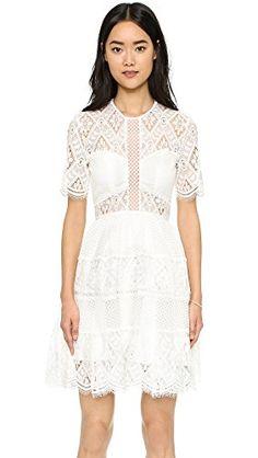 A modern lace #Alexis dress with a slim bodice and a full, pleated skirt. Tonal lining lends an alluring peek-a-boo effect. Short sleeves. Hidden back zip. Semi-...