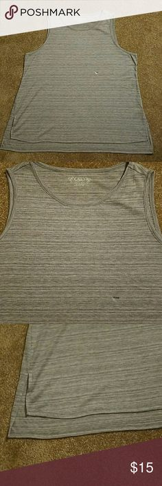 NWT Heather grey tank from Cato 18 20W Brand new. Measures approximately 23 inches from armpit to armpit. Hi lo but only abou an inch longer in back Cato Tops Tank Tops