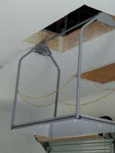 Wireless remote attic lift now this would make my life and we offer best quality homegaragelifts with free shipping these garage storage lifts makes solutioingenieria Images