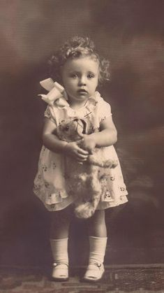 +~+~ Antique Photograph ~+~+   Sweet toddler with her beloved stuffed doggie.