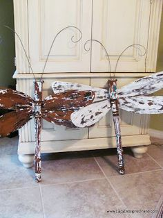 1 Table Leg + 4 Ceiling Fan Blades = Dragon Fly  These would look great on the fence out by my pool.