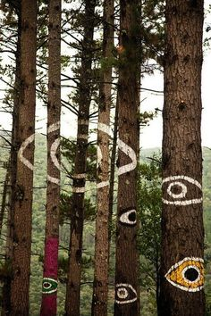 the trees have eyes | psychedelic art | painted forest | all seeing eye | trippy | installation art | bohemian fun