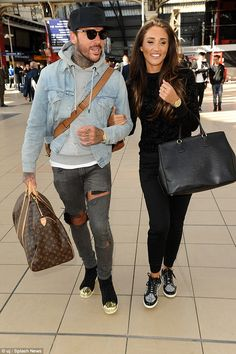 Loved-up: Megan McKenna, 23, and Pete Wicks, 27, looked quite the smitten couple as they strolled through Liverpool's Lime Street station on Tuesday