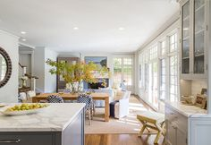 The Ultimate Gray Kitchen Design IdeasThe room is 35′-8″ long by 23′-5″ deep. The kitchen and dining room portions are both about 12′ wide. Rug: The designer, Benjamin Dhong, had a custom Seagrass carpet cut for this room. It's definitely a great addition to this space. Windows and doors are Sierra Pacific.