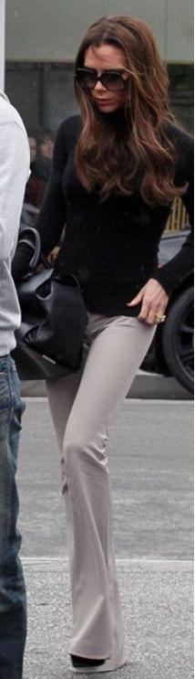 Victoria Beckham:  Sweater – Crumpet    Purse – Victoria Beckham Collection