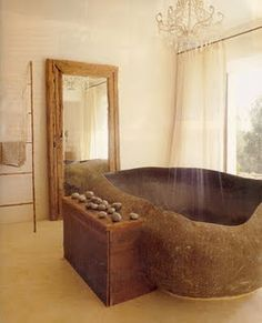 Bath tub carved out of stone. OBSESSED