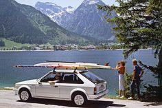 1983 Opel Kadett GTE Opel's first front wheel drive Kadett. My guess is that this could be Zell am See in Austria. I once spent a nice vacation there many, many years ago. Windsurfing was the new sport to do in those days, and Opel jumped on that bandwagon here. Opel publicity photo found on the internet.