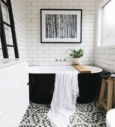 I live this tub. Beautiful black and white bathroom with white subway tiles, black grout, graphic geometric patterned floor, black freestanding bathtub and modern fine art photography. Bad Inspiration, Bathroom Inspiration, Bathroom Inspo, Bathroom Goals, Bathroom Colors, Bathroom Designs, Bathroom Renos, Bathroom Interior, Modern Bathroom