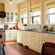 This is the same kitchen as the picture with three asterisks also saved to this board. Note the use of a white tile backsplash and white cabinets, punctuated by a black stone countertop with integral sink. Photo by Philip Clayton-Thompson. Black Countertops, 1920s Kitchen, Kitchen Remodel, Kitchen Design, Kitchen Inspirations, Bungalow Kitchen, Kitchen Countertops, New Kitchen, Craftsman Kitchen Cabinets