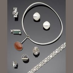 Vivianna Torun Bülow-Hübe for Georg Jensen A 'Dew Drop' Pendant Neckring the horizontal oval jasper pendant on a plain bar and hook terminal...