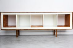 The addition of wood paneling upgrades this IKEA expedit to a mid century modern inspired sideboard.
