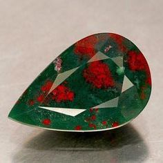 Bloodstones were believed to be a magical stone in ancient times.  Touching the stone simply stopped hemorrhages. Ancient warriors carried with them bloodstone amulets for reasons to stop the bleeding whenever they had wounds.