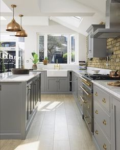 Imagine spending sunny summer days chilling out and cooking and pottering about in this lovely Shaker kitchen. The skylights flood this room with the softest light and the big central island is the perfect little spot for friends and family to gather. #deVOLKitchens