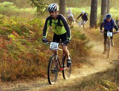 Mountain bike racing (shortened MTB or ATB racing) is the competitive cycle sport discipline of mountain biking held on off-road terrain Mountain Bike Races, Best Mountain Bikes, Mountain Bicycle, Forest Mountain, Mountain Trails, Dirt Bike Helmets, Sports Website, Bike Photography, Bmx Bikes