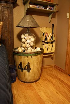 Love this baseball lamp/table and the bats on the wall.