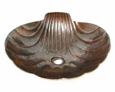 Copper sea shell sink, maybe for an ancient greek or roman themed bathroom