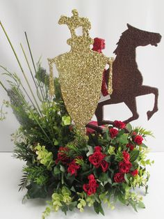 This Kentucky Derby themed centerpiece will actually be a topper to a cupcake tree for a Kentucky Derby party. Our customer wanted all the elements of a race horse and jockey, the winners trophy, h…