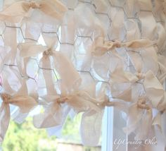 """Chicken wire valance--Cut fabric into 2 1/2"""" strips.Weave fabric through the wire holes up & down the holes.Just tie on a new piece when reaching end of wire.Avoid having all of the ties in the same location by cutting strips into different lengths.Tie strips onto the edge of the valance & in some random spots.Staple valance to a board & attach to window."""