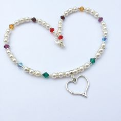 A personal favourite from my Etsy shop https://www.etsy.com/uk/listing/286815505/ivory-swarovski-pearl-and-multicolour