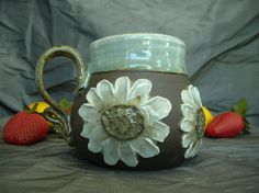 Ceramic Mug with Daisies in Sky Blue, Summer White and Black Mountain by Sally Anne Stahl. www.clayshapergallery.com