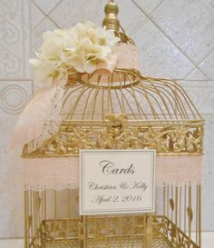 ♥♥♥♥♥♥♥♥♥♥♥♥♥♥♥♥♥♥♥♥♥♥♥♥♥♥♥♥♥♥♥♥♥♥♥♥♥♥♥♥♥♥♥♥♥♥♥♥♥♥ Comes with your choice of paint, ribbon, and flower colors! ♥♥♥♥♥♥♥♥♥♥♥♥♥♥♥♥♥♥♥♥♥♥♥♥♥♥♥♥♥♥♥♥♥♥♥♥♥♥♥♥♥♥♥♥♥♥♥♥♥♥  Shown painted gold, with blush satin ribbon, ivory lace, ivory hydrangeas, and ivory cards sign.  Cage measures approximately 19 x 10 x 7. It will hold approximately 100-150 cards.  If you need something SMALLER please visit the link below. https://www.etsy.com/listing/482348185/small-champagne-gold-wedding-...