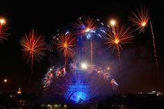 Fireworks illuminate the Eiffel Tower in Paris during Bastille Day celebrations late Monday, July 14, 2014. Bastille Day marks the July 14, 1789, storming of the Bastille prison by angry Paris crowds that helped spark the French Revolution.