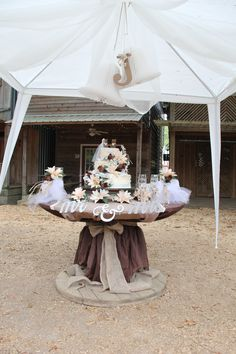 wedding cake table. Just a simple large decorated spool