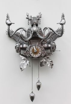 Cuckoo Clock ♥ ... Out of recycled bit & pieces to make for a monumental wonder! Tick Tock!  More information at Jeugdstijl: Sick and twisted art website or Facebook.